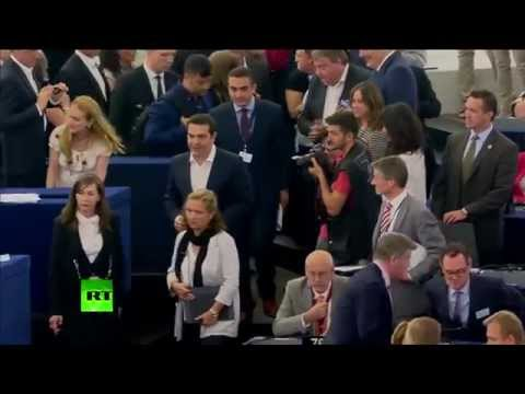 Applause & Booing: Moment Tsipras walks into European Parliament