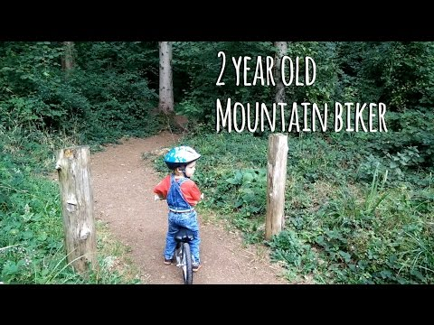 2 year old bonds with father over mountain biking