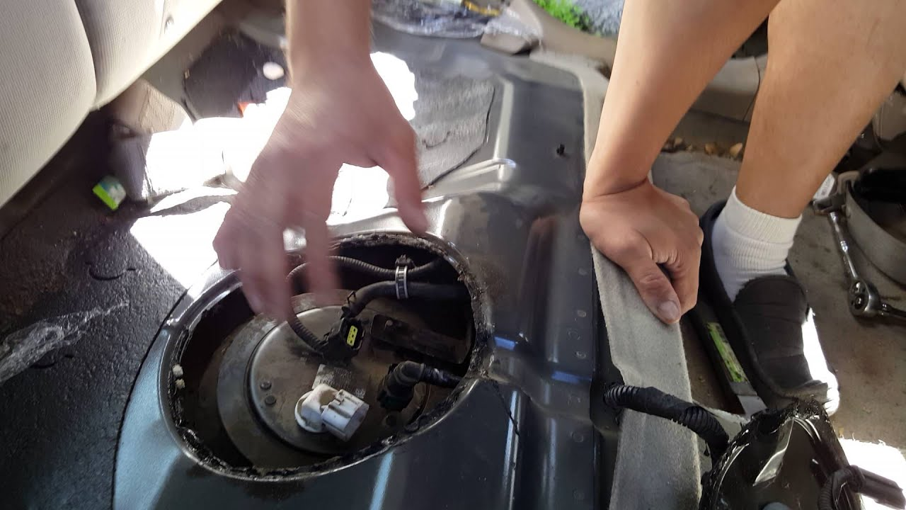 how to remove the fuel sending unit on a 2005 kia spectra [ 1280 x 720 Pixel ]
