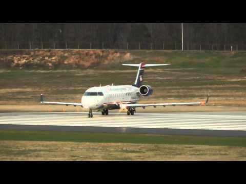 3 US Airways Express Bombardier CRJ-200ER planes taking off at Charlotte Douglas Intl