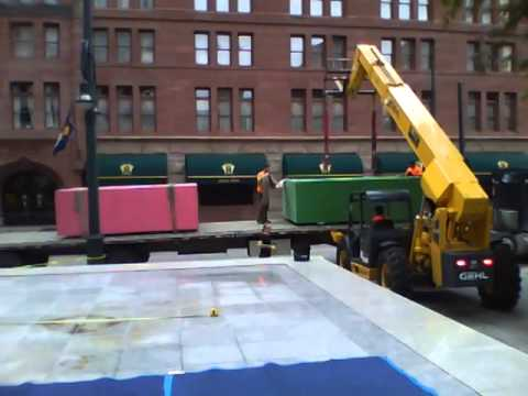 Unloading Mike Whiting Monumental sculptures at Republic Plaza, Denver, CO  2014