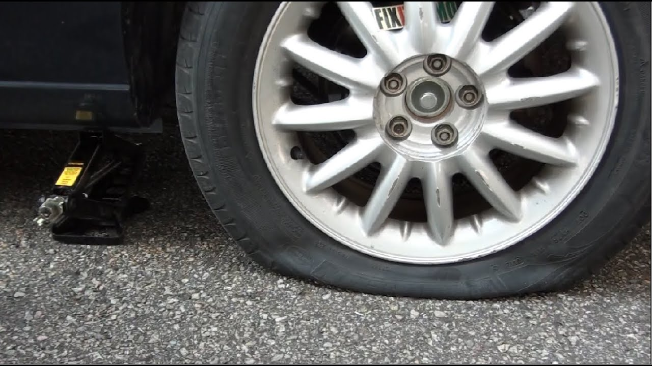 how to change a flat tire If you're stuck on the side of the road because of a flat tire, don't worry we walk you through changing your tire, so you can get back on the road.