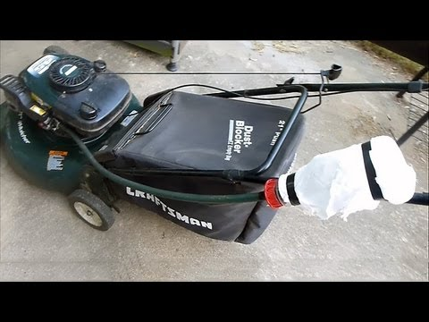 Adding Sea Foam To Lawn Mower Fuel Intake Cleaning With
