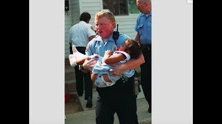 After 19 years, police officer and toddler he saved reunite