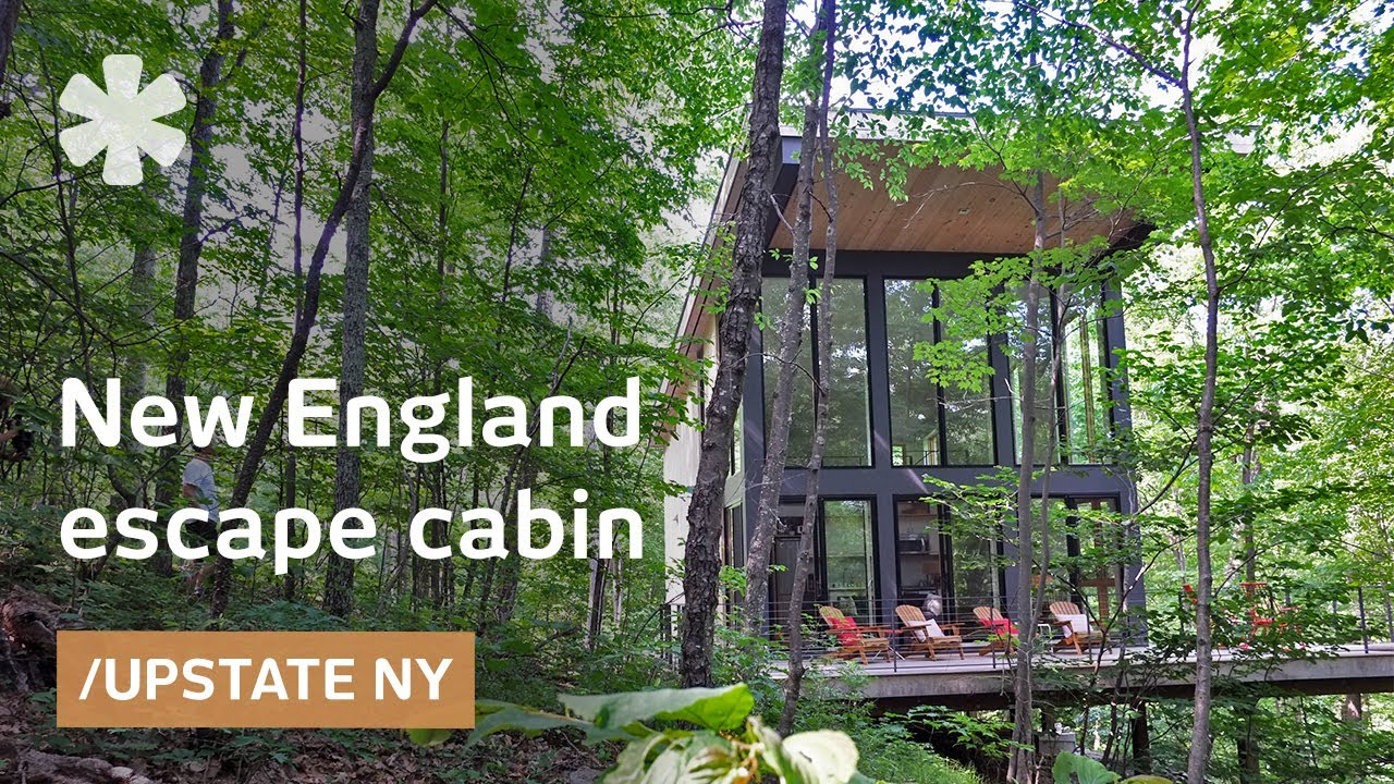 Modern cabin hangs like a treehouse over Acadian New England