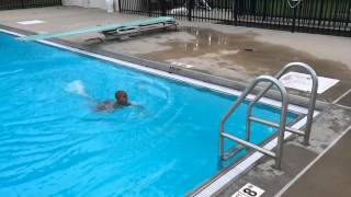 5 year old jumps from diving board.