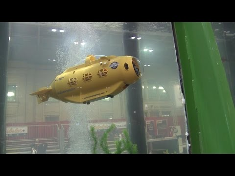 RC-TV - Sneaking a Neptune SB-1 RC Sub into the Fish TV fish tank
