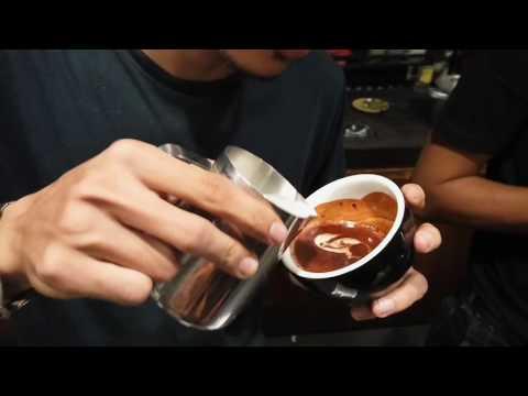 "Latte art ""swimming swan"" by barista Onis"