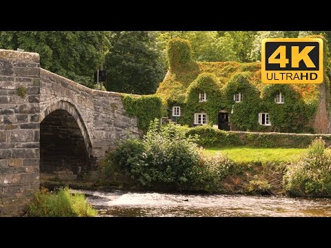 Peaceful 4K Video of a Countryside Cottage by a River in Wal