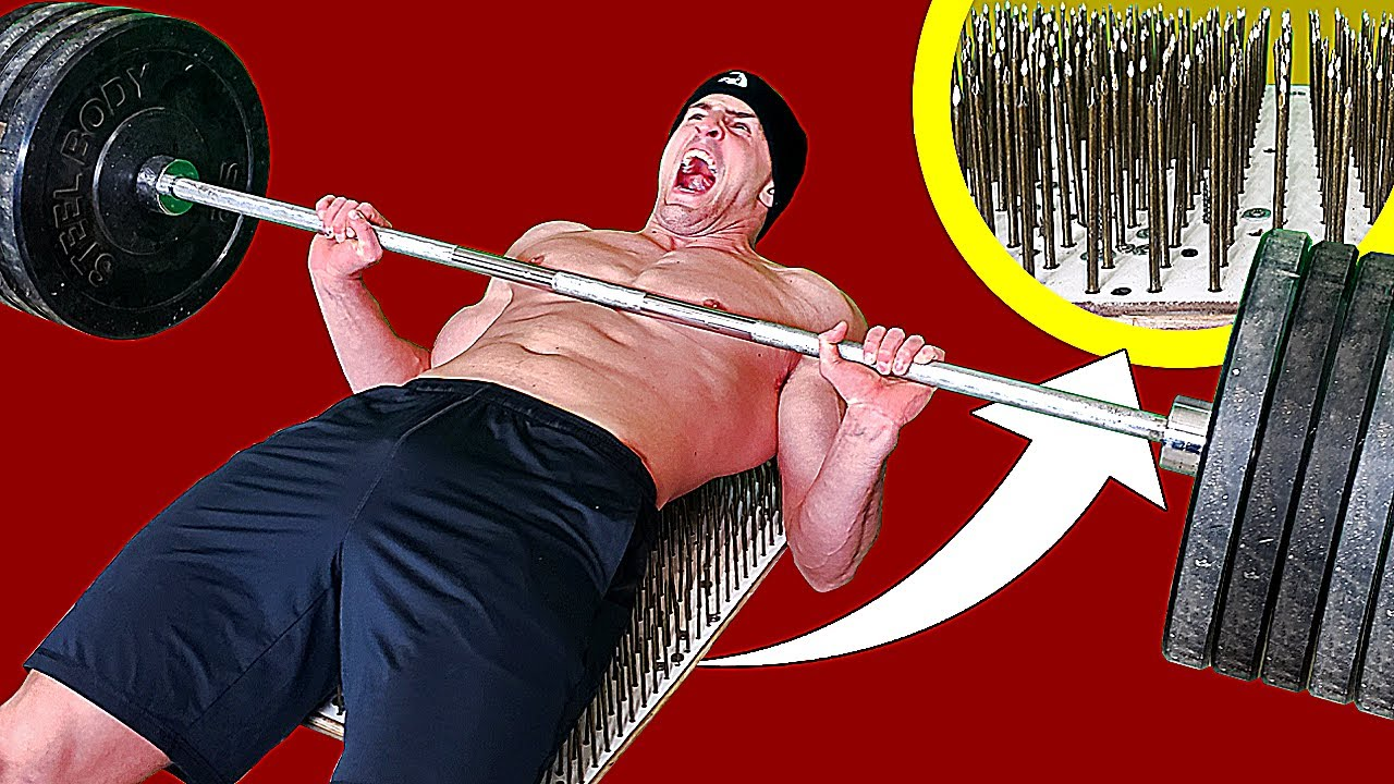 Bench Pressing on a Bed of Nails *PUNCTURE WOUNDS* | Bodybuilder VS Extreme Powerlifting Challenge