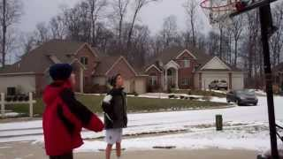 Kid kicks friend after losing in basketball