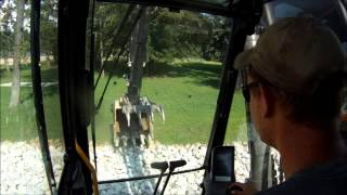 Excavator Placing Rip Rap