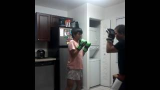 Dad training autistic son in boxing...