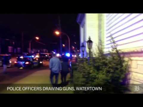 Police officers draw guns in Watertown