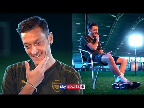 Why does Mesut Ozil think people call him a 'lazy player'?