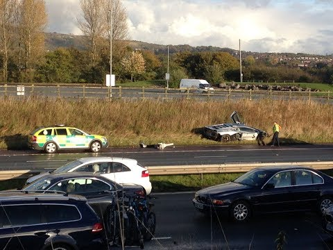 ►Lamborghini supercar worth £260,000 is left DESTROYED on the verge after BMW M6 CRASH