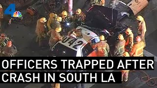 Los Angeles Police Officers Trapped in Patrol Car After Violent Crash | NBCLA