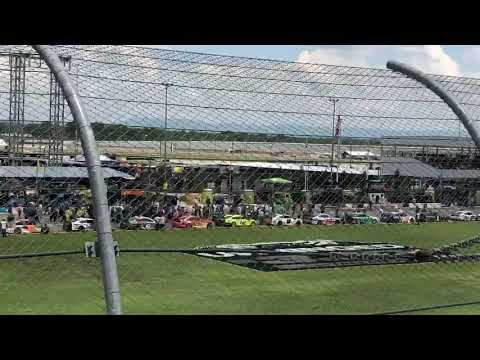 NASCAR drivers and crew push Bubba Wallaces car to the front for pre-race ceremonies at Talladega
