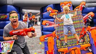 NERF BOUNCY HOUSE BATTLE AT VIDCON!! 💥 (Kids VS. Adults)