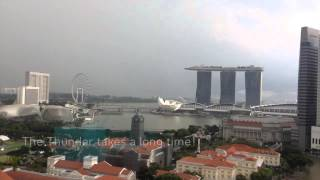 Singapore Flyer hit by lightning & thunder storm over Marina Bay Sands, Singapore