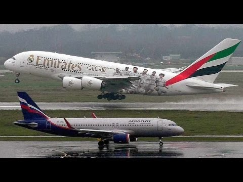 Emirates A380 gusty and wet landing and take-off at Duesseldorf Airport
