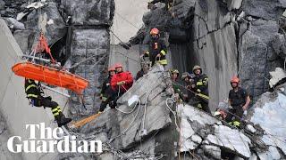 Genoa bridge collapse: rescuers search for survivors