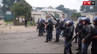 Police fired rubber bullets at residents who looted shops and blocked roads in protest against effective policing. The protest comes after a spate of vigilante attacks.