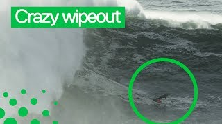 Surfer Rescued after Huge Wipeout in Nazare, Portugal