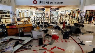 HK protesters block road with fire, vandalize subway station