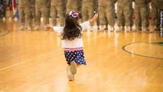 Little Girl Hugs Dad Before Military Ceremony Ends - Newsy thumbnail