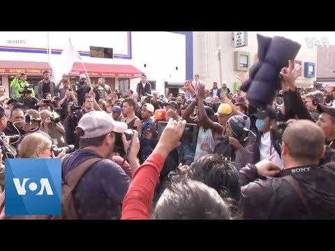 Migrants March Towards Border Crossing in Defiance of Trump
