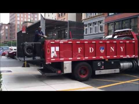 RARE CATCH OF FDNY TIRE TRUCK CHANGING TIRE ON FDNY ENGINE 5 IN CAGE OUTSIDE FDNY ENGINE 33 HOUSE.
