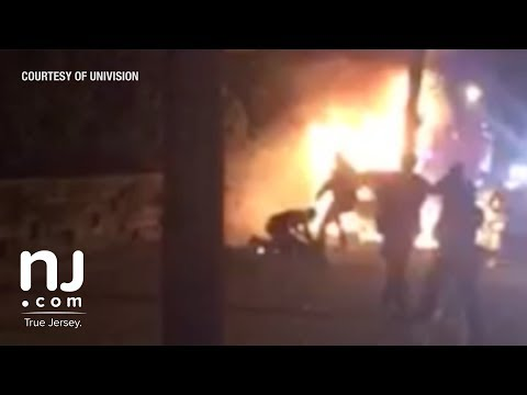 Footage shows police kicking victim of fiery crash (Warning: video contains graphic content)