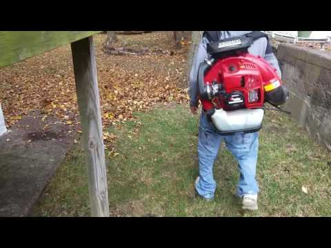 redmax-8500-back-pack-blower-blowing-leaves