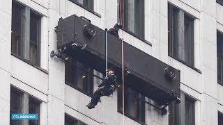 Glazenwassers uren vast in kapotte gevellift op 18e verdieping in Den Haag