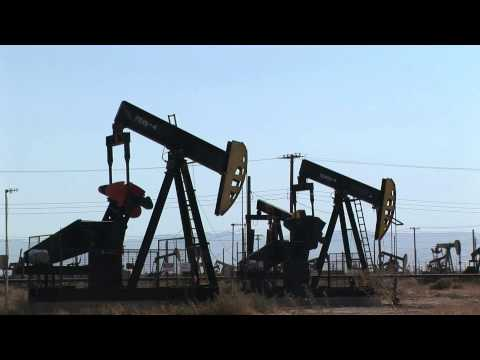 Pumpjack Oil Pumps Deliver Texas Crude Oil by BottledVideo.com