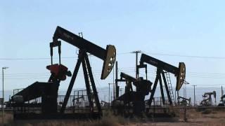 Pumpjack Oil Pumps Deliver Texas Crude Oil by BottledVideo.com