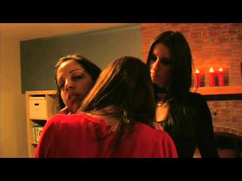 Two Female vampires bite a woman