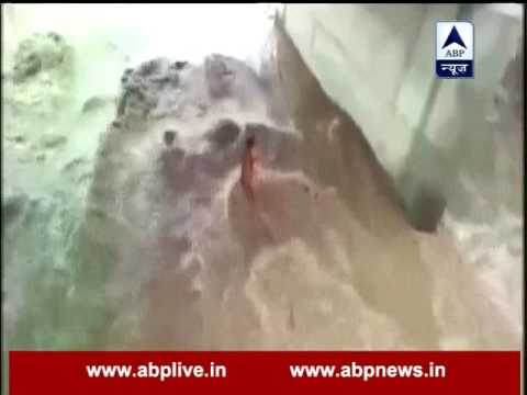 Monsoon in India: Watch how a man held tight on a rope while stuck in Rajasthan flood