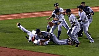 Youkilis charges the mound after being hit