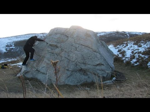 Outdoor practice for scrambling in Calgary Nose Hill easy bouldering