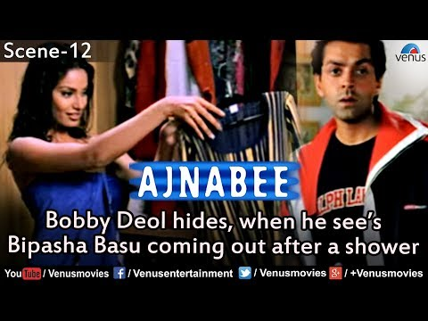 Bobby Deol hides, when he see's Bipasha Basu coming out after a shower (Ajnabee)