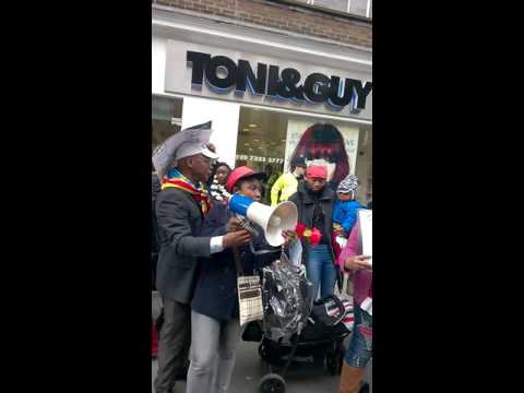 Activist Bosembo of Congo Support project protest at DRC Embassy in London