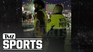 Ezekiel Elliott Handcuffed at EDC Vegas After Knocking Man to the Ground | TMZ Sports