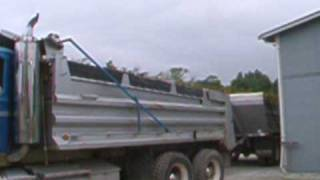Loading manure into a truck and pup