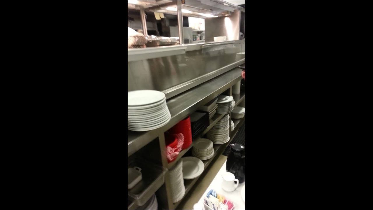 A server teaching a cook how to make a baste eggs - YouTube