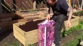 Another day in the allotment garden, finally getting my last raised bed finished. It