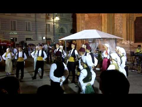 Traditional Bosnian dance by performers in open square in old town Sarajevo