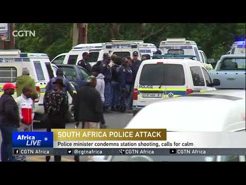 South Africa's police minister condemns station shooting, calls for calm