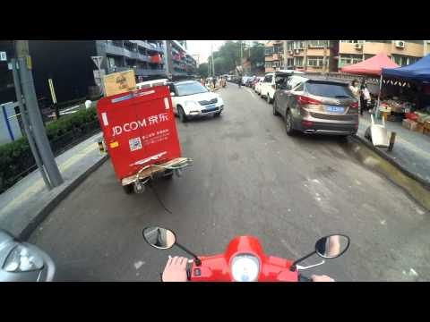 Beijing Police Officer Driving the Wrong Way AND in the Bike Lane